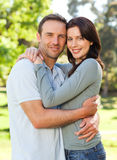 Radiant couple hugging in the park Royalty Free Stock Photos