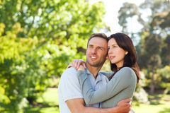 Radiant couple hugging in the park Royalty Free Stock Photography