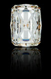 Radiant diamond on black with reflection. Royalty Free Stock Photos