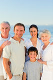 Radiant family at the beach Stock Photography