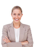 Radiant female executive with folded arms. Against a white background Stock Photos