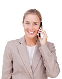 Radiant female executive on phone Stock Photo