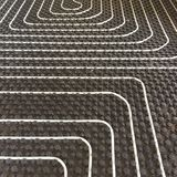 Radiant floor Heating system detail. Intalation of radiant heating floor system on the pavement of a home Royalty Free Stock Photos