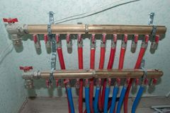 Radiant Floor Heating Installation Heating System. Man install underfloor water heating floor construction. Floor heating stock images
