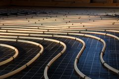 Radiant floor heating system. Construction of house. Tubing are elements of radiant floor heating system stock image