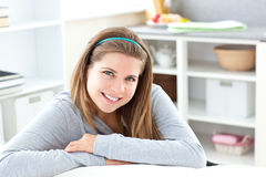 Radiant girl smiling at the camera. At home Royalty Free Stock Image