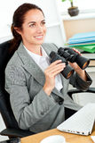 Radiant hispanic businesswoman holding binoculars Stock Photos