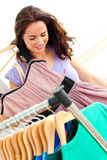 Radiant hispanic woman looking for clothes Royalty Free Stock Photography
