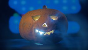 Radiant jack-o-lantern located in a dark room with a party in it. Happy halloween pumpkin concept.