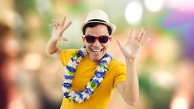 Radiant man celebrates. Man smiling at party. Brazilian. Carnival. Brazilian celebrating. Tourist. Travel. Man goes on vacation. Man is having fun. He is wearing royalty free stock photography