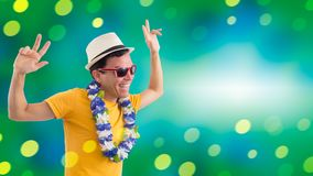 Radiant man celebrates. Man smiling at party. Brazilian celebrat. Carnival. Brazilian celebrating. Travel. Vacation. Man is having fun. He is wearing a yellow royalty free stock photo