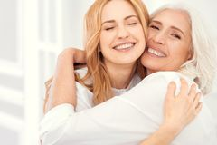 Free Radiant Mother And Daughter Beaming Into Camera While Hugging Stock Images - 113968494