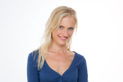 Radiant nordic girl in dark blue shirt smiling with head bent at Stock Images