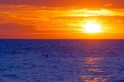 Radiant orange sunset over blue wavy sea. Radiant orange sunset over blue wavy Adriatic sea in Croatia royalty free stock images