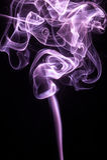 Radiant orchard smoke on black background Royalty Free Stock Photos