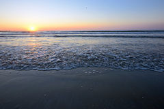 Radiant sea beach sunrise. In summer time Stock Photo