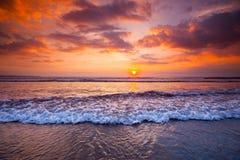 Radiant sea beach sunset Stock Images