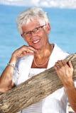 Radiant senior lady outdoors Stock Photo