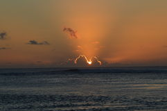 Radiant Sunset. A sunset over the reef lagoon on Rarotonga.  Photo taken January 2014 Royalty Free Stock Images