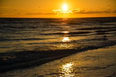 Radiant Sunset. Such as nice view of this radiant color of Sun setting in above the horizon royalty free stock photography