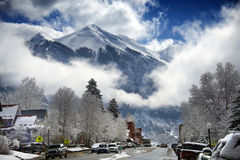 Radiant Winter Clouds Frame the Mountains of Telluride Colorado. Snow, ice and crystalline clouds sweep through the Telluride morning high in the Colorado Stock Photography
