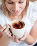 Radiant woman drinking a coffee Stock Photography