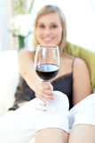 Radiant woman drinking red wine Stock Image