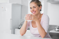 Radiant woman having coffee Royalty Free Stock Photo