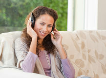 Radiant woman listening to music Royalty Free Stock Images