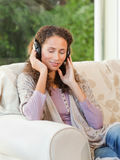 Radiant woman listening to music Royalty Free Stock Image