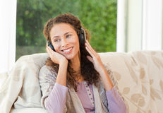 Radiant woman listening to music Stock Photography