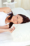 Radiant woman sleeping in her bed Stock Photos