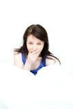 Radiant woman yawning sitting on her bed Royalty Free Stock Photo