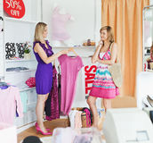 Radiant women choosing clothes together Royalty Free Stock Photography
