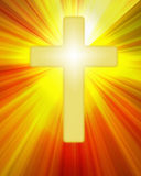 Radiant yellow cross symbol on bright rays. Golden radiant cross symbol shining on a background of bright rays royalty free illustration