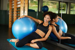 A radiant young black woman smiling brightly relaxing after workout Stock Photography