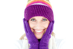 Radiant young woman with cap and gloves smiling Royalty Free Stock Photo