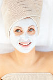 Radiant young woman having white cream on her face Royalty Free Stock Photography