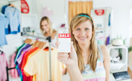 Radiant young woman holding a  Royalty Free Stock Photo