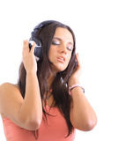 Radiant young woman listen to music Stock Image
