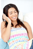 Radiant young woman listening music Royalty Free Stock Photography
