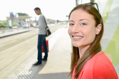 Radiant young woman waiting on platform Royalty Free Stock Photos