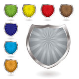 Radiate shield. Colorful radiating shields with drop shadow and silver bevel Stock Photography