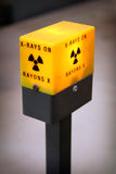 Radiation Alert Light. A radiation alert light used on an X-Ray Diffraction Machine. The machine is used by Mineralogists to determine what minerals are in a stock image