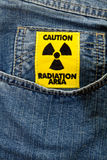 Radiation area caution sign. On a blue jeans background Royalty Free Stock Images