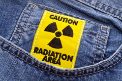 Radiation area caution sign 2. Radiation area caution sign on a blue jeans background royalty free stock images