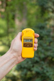 Radiation check. Checking radiation level with a personal dosimeter stock photos