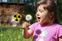 Radiation danger. Concept of radiation danger with kid near of old nuclear power plant Royalty Free Stock Photography