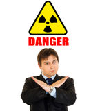 Radiation danger! Businessman with crossed arms Stock Image