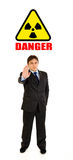 Radiation hazard! Businessman showing stop gesture Stock Photo